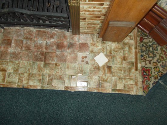 Ronald Reagan Boyhood Home: President Reagan would hide change under this loose tile.
