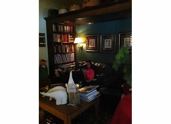 Wickwood Inn: My fiancé reading in the study.