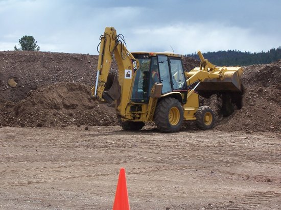 Dumping a big load of dirt with the backhoe - Picture of Big