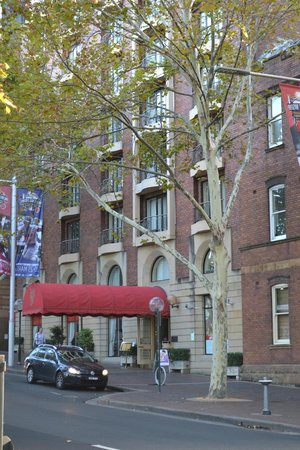 Sir Stamford at Circular Quay Hotel Sydney: red awning of hotel from across the street