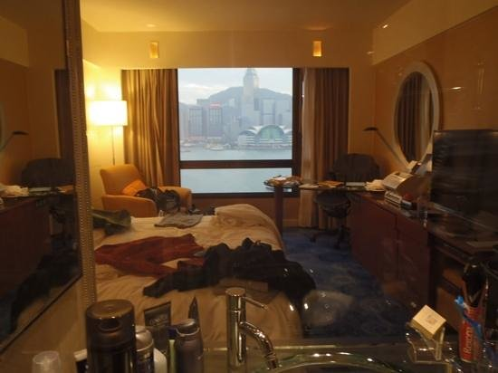Sheraton Hong Kong Hotel & Towers: besides our mess, the view from the bathroom is pretty cool.
