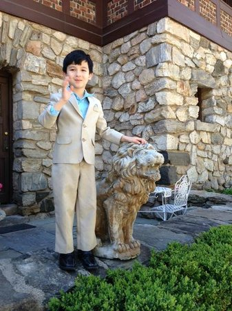 Le Chateau: My grandson, Denis, with one of two lions that guard the front door.