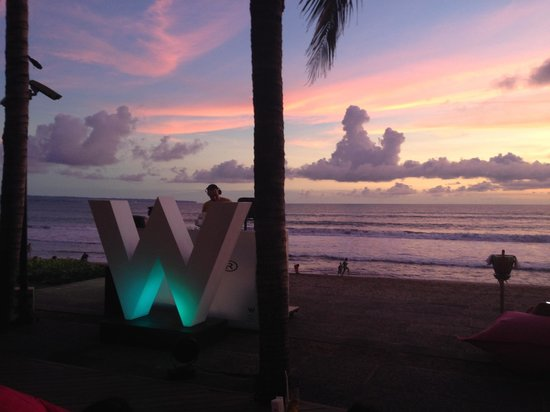 W Bali - Seminyak: View from our table at Woo Bar. Thats a D.J behind the W. Awesome tunes and spectacular sunset.
