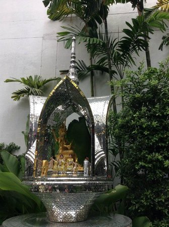 The Continent Hotel Bangkok by Compass Hospitality: A Thai shrine outide hotel grounds