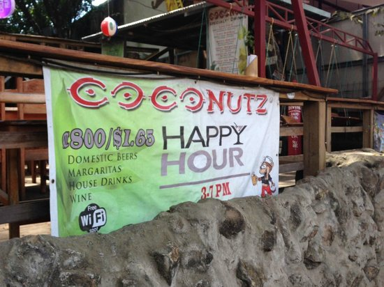 Coconutz Sports Bar & Angry Goats Brew House: Out door happy hour advertising Coconutz Sports Bar & Eatery  |  Main St, Playas del Coco 5019,