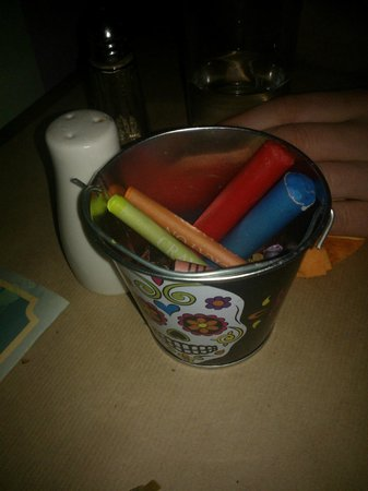 The Hungry Mexican: Tub of the crayons left on the table.