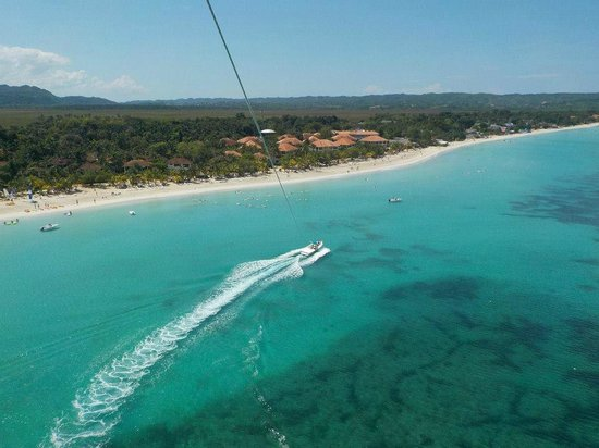 Couples Swept Away: Parasailing over the resort