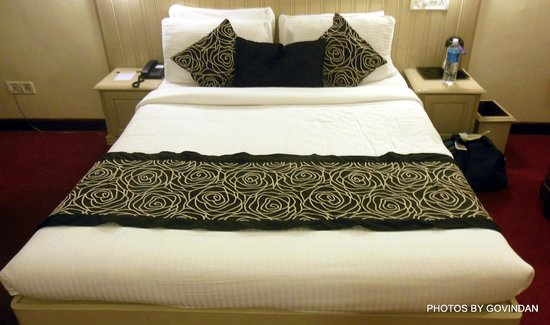 Abad Copper Castle Hill Valley Resort : Bed in room
