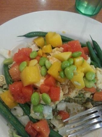 Aqui Cal-Mex: Thai Peanut Bowl with Tofu. Tofu with fresh mango, rice, soy beans, papaya, and peanut sauce!