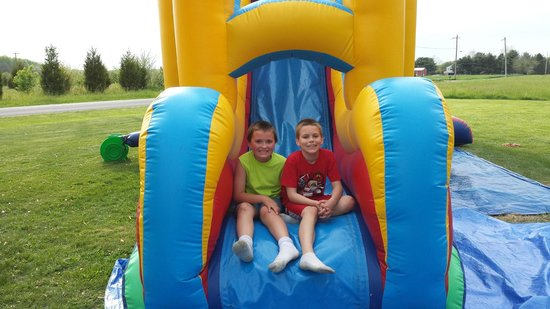 Hoppin Good Time: Garrett and Daniel having a great time in Combo Inflatable