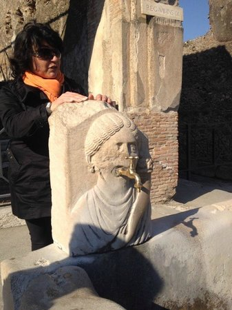 Lucia Pompeii Guide Tours: Lucia explains various things one sees in the streets of Pompeii