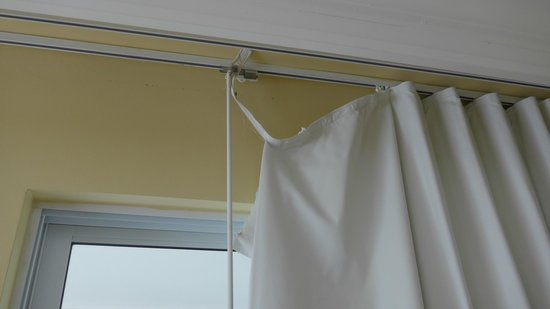 The Sands at Grace Bay : Torn privacy drapes