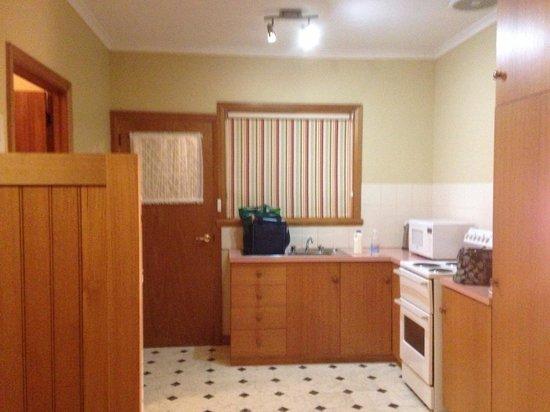 Anabel's of Scottsdale: Kitchen Unit 3- full size fridge behind wooden panel