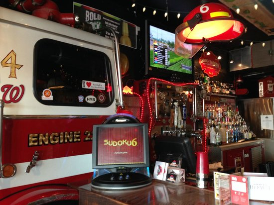 The Halligan Bar and Grill: fire truck behind the bar