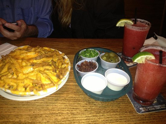 Snuffer's: Cheese fries with toppings and margaritas.