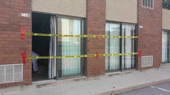 Comfort Inn - Highway 401: Caution tape outside room from construction