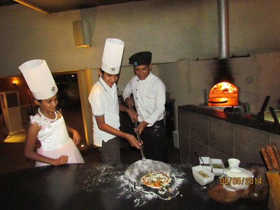 Mediterra at Sayaji Hotel : Harshit on the way to put Pizza on wooden Oven