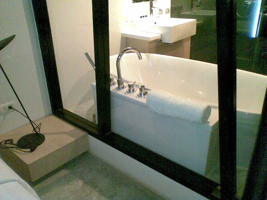 Vismaya Suvarnabhumi Resort: Bathroom adjoins room with a see through look (and curtain if u like)