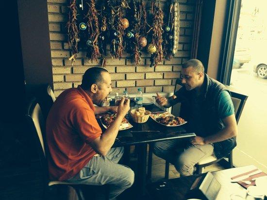 Sultan Bbq: Me and friend enjoying iskender kebab