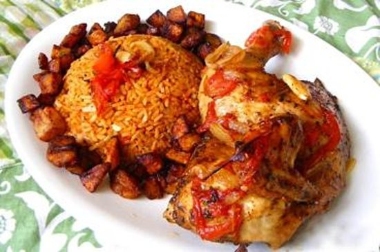 Jollof rice served with fresh fish plantain and for Afrikaner cuisine