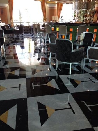 Iberostar Grand Hotel Paraiso: Inlaid marble tile floor (martini glasses!) in main lobby bar