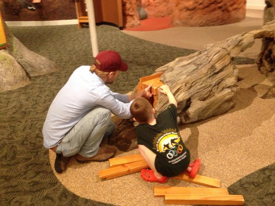 Sandy Creek Nature Center: Trying the log-to-lumber puzzle.