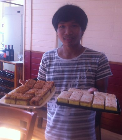1904 Cafe Mangonui: Baker Joni fred with Custard Fingers & Raspberry Coconut Slice