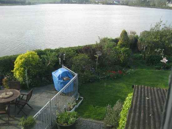 Cairbre House: View of a corner of the garden, and Colligan River from our room.