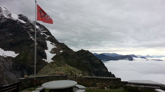 Glecksteinhutte: Swiss Flag and low morning clouds