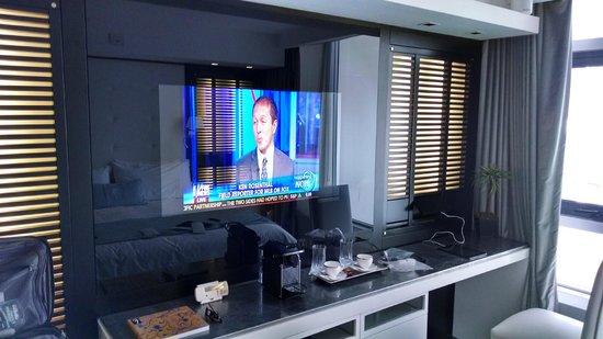 1828 Smart Hotel: flat screen tv and backlit louvre'd panels