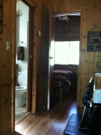 Paradise on the River : River Bend cabin: view from living room into bedroom