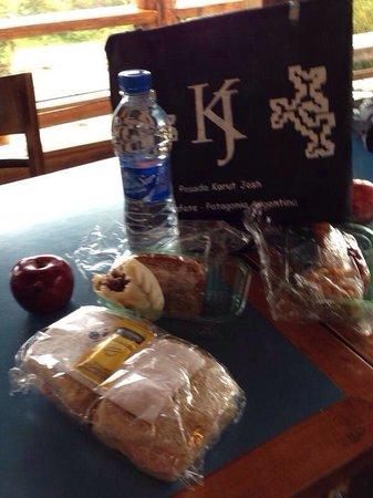 Posada Karut Josh: Lunch box, nice bag and homemade empanada plus sandwich!