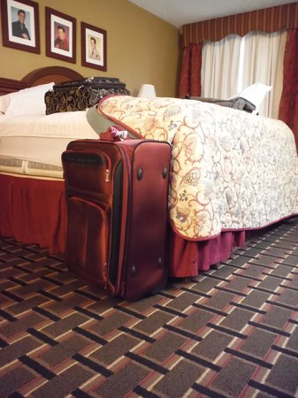 """Days Inn Memphis at Graceland: Fullsize suitcase next to the """"King"""" bed"""