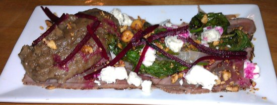 Liquids and Solids at the handlebar: Beef Heart Carpaccio with porcini mashed potatoes, spinach, beets, blue cheese, and hazelnuts.