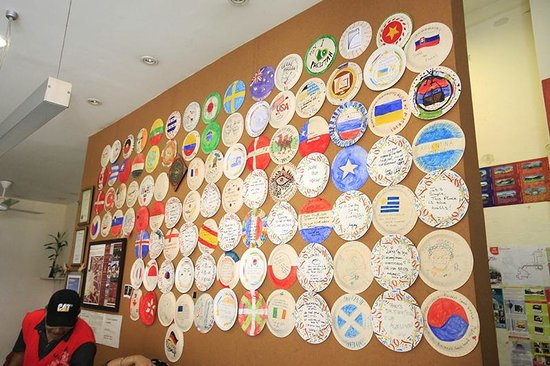 Raizzy's Guesthouse: Wall of the Plates! I left my one as well