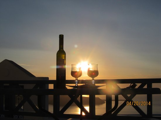 Absolute Bliss Imerovigli Suites: Classic Santorini sunset and a bottle of local wine.