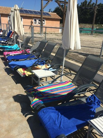 Aliathon Holiday Village: Reserved beds at 11AM