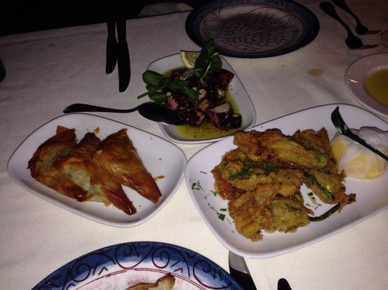 Kokkari Estiatorio: Clockwise from left Spanakopita, grilled octopus and courgette flowers deep fried in batter