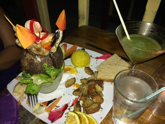 Habanero's Restaurant: Stone crab claws, shrimp, and snapper presented in a coconut (with frozen Mojito in the backgrou