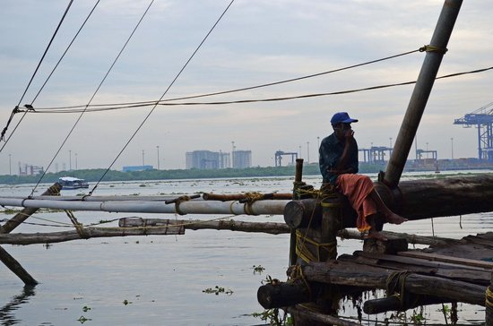 fisher man near chinese fishing nets