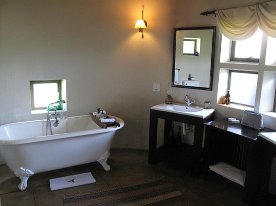 Sabi Sabi Selati Camp: Bungalow, one of the bathrooms. The other is outside
