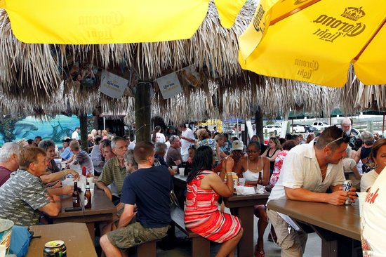DJ's Deck : Dinner on the river under the tiki huts.