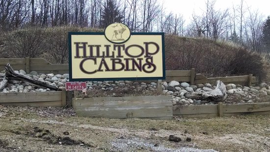 Hilltop Cabins sign at beginning of drive