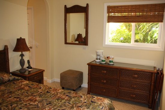 Maui Beach Ocean View Rentals: Plumeria Room with firm Queen bed, mini fridge, coffeemaker, access to microwave and barbecue