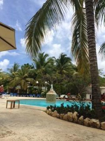 Meliá Caribe Tropical: A glimpse of the pool area. It's much bigger then this picture shows