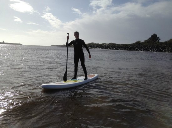 Bazil's Hostel & Surf School: Paddle boarding on the Buller River.