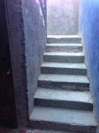 Casa Margarita's: Unpainted, dusty concrete steps leading to our rooms