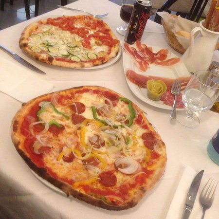 Pizzeria Ristorante alla Rotonda : Pizza Adri (foreground) and pizza Azzurro (back) out of stone oven fired with wood