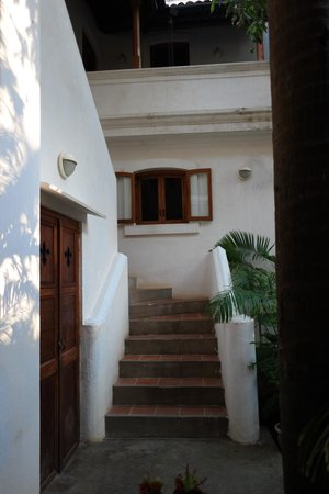 Gratitude, a Heritage Home: stair access to the upper floor rooms