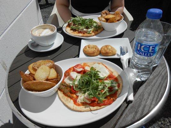 Cafe Eighteen: Mozzarella, tomato & pesto flatbread with potato skins. Behind: Mexican chilli & jalapeno flatbr